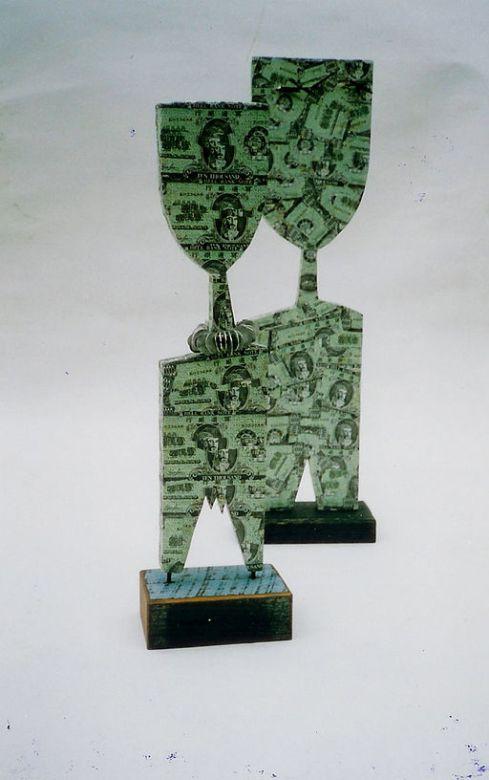 512px-OM_Money_Launders_1999